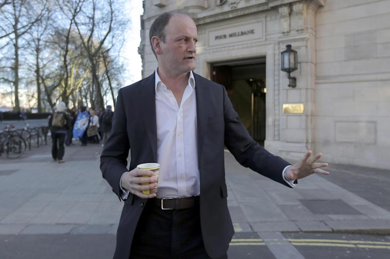 Resignation: MP Douglas Carswell leaves a television studio in central London: REUTERS