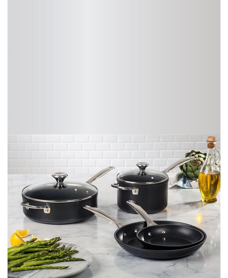 "For those who are practically chefs in the kitchen and into investing in the right cookware, this Le Creuset set features a toughened non-stick surface and responses well to quick changes in heat (like when you're switching from high heat to low). You're getting two fry pans, a sauce pan and sauté pan with this set. <a href=""https://fave.co/35KPhml"" target=""_blank"" rel=""noopener noreferrer"">Originally $570, get it now for $297 at Macy's</a>."