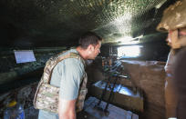 FILE - In this Thursday, Aug. 6, 2020 file photo, Ukrainian President Volodymyr Zelenskyy looks through an embrasure as he visits the war-hit Donetsk region, eastern Ukraine. Ukraine's leader is traveling to the United States in hopes of bolstering security ties with Washington and persuading the Biden administration to ramp up sanctions against a new Russian gas pipeline that bypasses his country. (Ukrainian Presidential Press Office via AP, File)