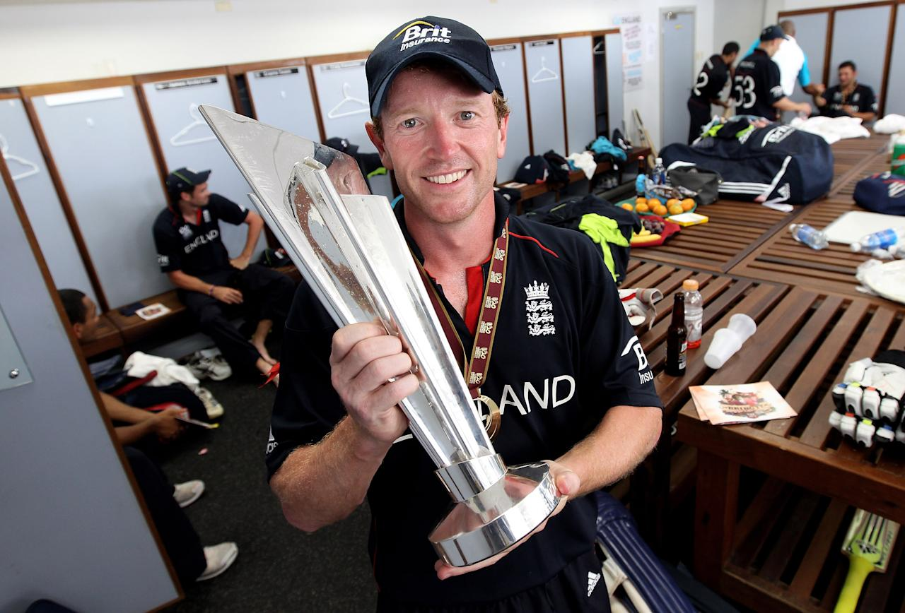 BRIDGETOWN, BARBADOS - MAY 16:  England captain Paul Collingwood with the trophy in the teams dressing room after his teams victory against Australia in the final of the ICC World Twenty20 played at the Kensington Oval on May 16, 2010 in Bridgetown, Barbados.  (Photo by Julian Herbert/Getty Images)