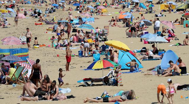 People flock to the beach in Margate, Kent. (PA)