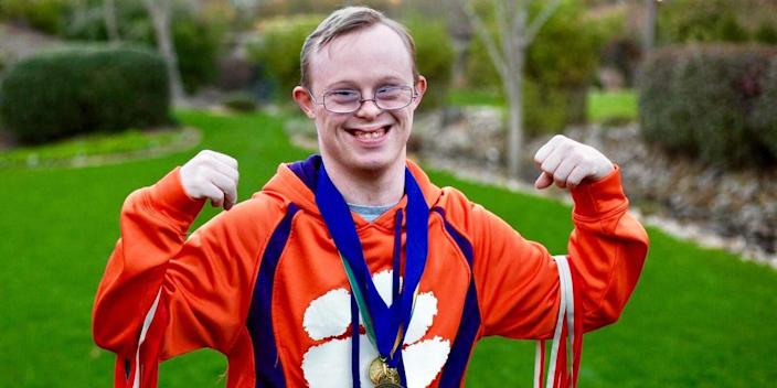 Rion Holcombe with medals (Molly Claire Photography / Courtesy of Susan Holcombe)