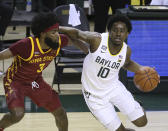 Baylor guard Adam Flagler (10) drives the ball against Iowa State guard Tre Jackson (3) in the second half of an NCAA college basketball game, Tuesday, Feb. 23, 2021, in Waco, Texas. (AP Photo/Jerry Larson)