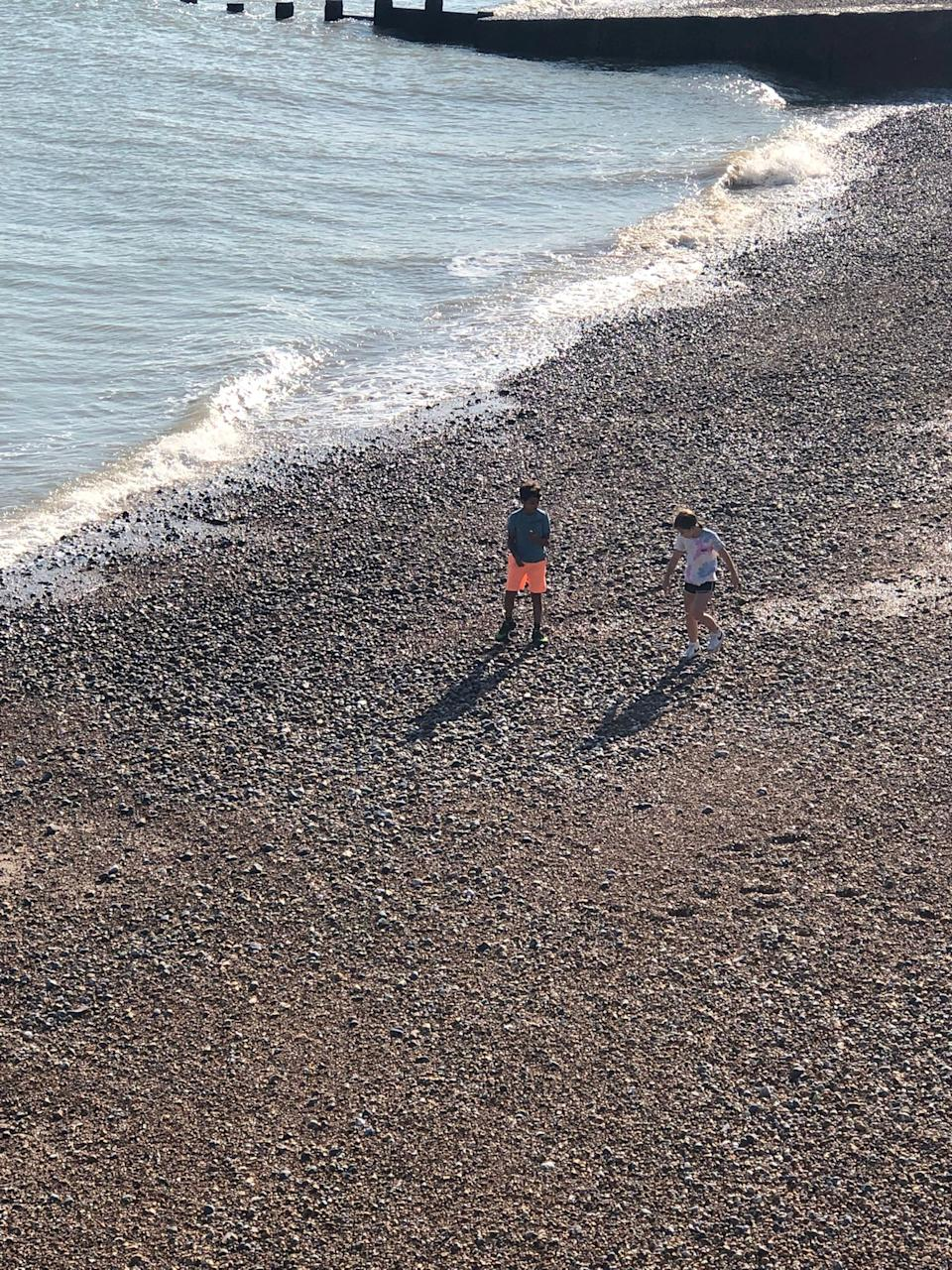 Oliver Quarte with a friend on the beach near Hastings before the incident (SWNS)