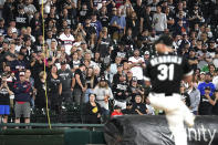 Fans stand as they watch Chicago White Sox relief pitcher Liam Hendriks work during the ninth inning of a baseball game against the Detroit Tigers in Chicago, Saturday, Oct. 2, 2021. (AP Photo/Nam Y. Huh)