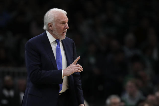 "While the upcoming Olympics will now take place ""no later than 2021,"" both Jerry Colangelo and Gregg Popovich still plan to lead USA Basketball. (AP/Charles Krupa)"