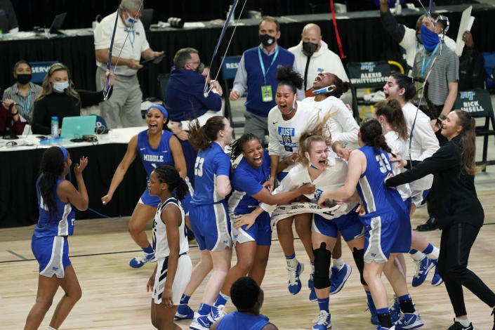 Middle Tennessee players celebrate at the end of the championship game against Rice in the NCAA Conference USA women's basketball tournament Saturday, March 13, 2021, in Frisco, Texas. Middle Tennessee won 68-65. (AP Photo/Tony Gutierrez)