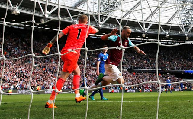 "Soccer Football - Premier League - West Ham United vs Everton - London Stadium, London, Britain - May 13, 2018 West Ham United's Marko Arnautovic celebrates a goal Action Images via Reuters/Paul Childs EDITORIAL USE ONLY. No use with unauthorized audio, video, data, fixture lists, club/league logos or ""live"" services. Online in-match use limited to 75 images, no video emulation. No use in betting, games or single club/league/player publications. Please contact your account representative for further details."