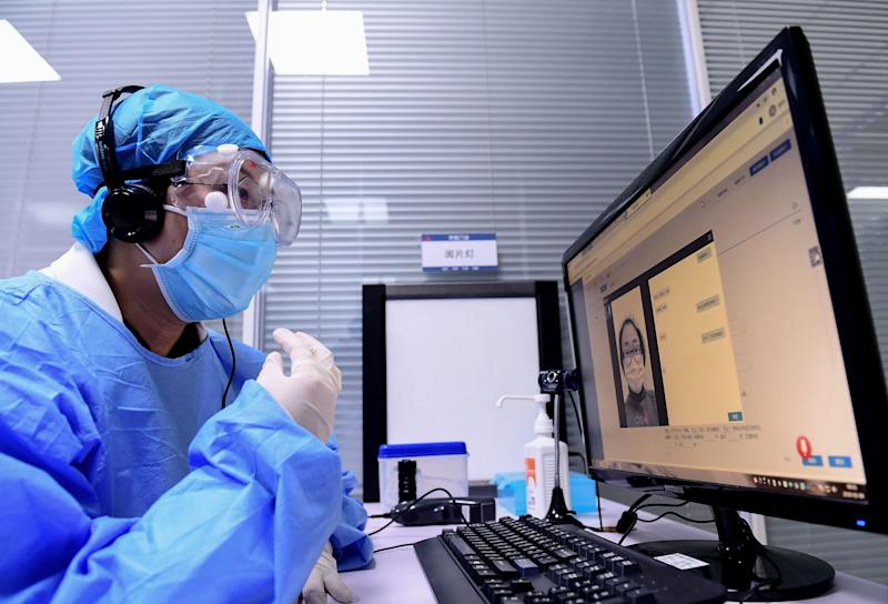 A doctor speaks with a patient during an online consultation session at a hospital in Shenyang in China's northeastern Liaoning province on February 4, 2020, amid an outbreak of a deadly SARS-like virus which began in the city of Wuhan. - The hospital provides the free online service to relieve the stress of face-to-face outpatient services and to avoid cross infection. The number of total infections in China's coronavirus outbreak has passed 20,400 nationwide with 3,235 new cases confirmed, the National Health Commission said on February 4. (Photo by STR / AFP) / China OUT (Photo by STR/AFP via Getty Images)