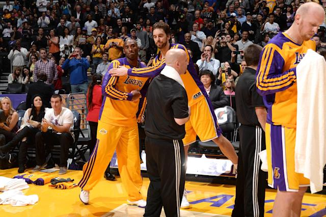 LOS ANGELES, CA - NOVEMBER 15: Pau Gasol #16 of the Los Angeles Lakers embraces teammate Kobe Bryant #24 during a game against the Memphis Grizzlies at Staples Center on November 15, 2013 in Los Angeles, California. (Photo by Noah Graham/NBAE via Getty Images)