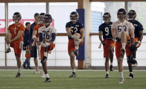 Chicago Bears players stretch during the NFL football team's rookie minicamp Friday, May 11, 2018, in Lake Forest, Ill. (AP Photo/Nam Y. Huh)