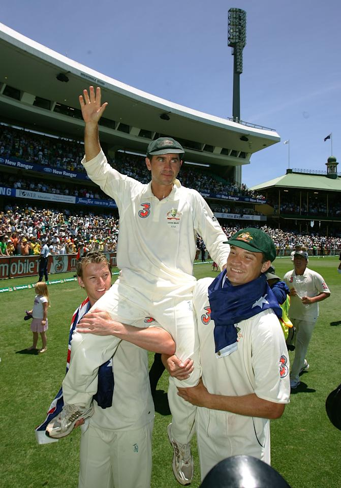 SYDNEY, AUSTRALIA - JANUARY 05:  Justin Langer of Australia celebrates on the shoulder of Stuart Clark (R) and Brett Lee after winning the final test and wrapping up the series 5-0 on day four of the fifth Ashes Test Match between Australia and England at the Sydney Cricket Ground on January 5, 2007 in Sydney, Australia.  (Photo by Hamish Blair/Getty Images)