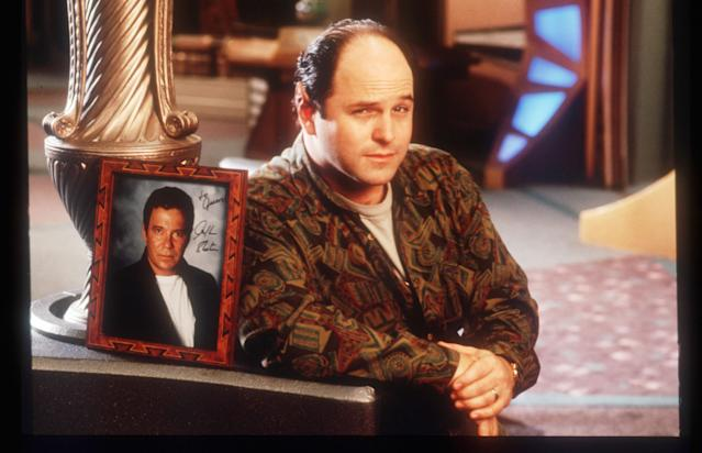 "Actor Jason Alexander Posing As A ""Vulcan"" While Sitting Next To A Picture William Shatner In Los Angeles, Ca. (Evan Agostini/Getty Images)"