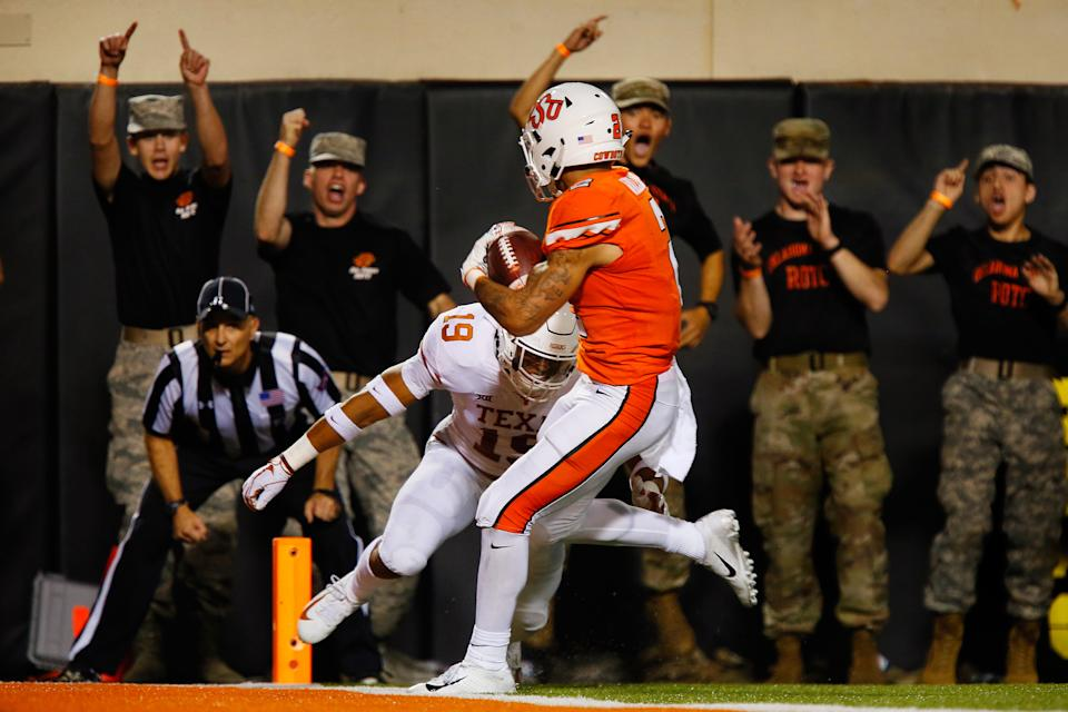 STILLWATER, OK - OCTOBER 27:  Wide receiver Tylan Wallace #2 of the Oklahoma State Cowboys scores with a 36-yard touchdown catch against defensive back Brandon Jones #19 of the Texas Longhorns in the second quarter on October 27, 2018 at Boone Pickens Stadium in Stillwater, Oklahoma.  Oklahoma State won 38-35.  (Photo by Brian Bahr/Getty Images)