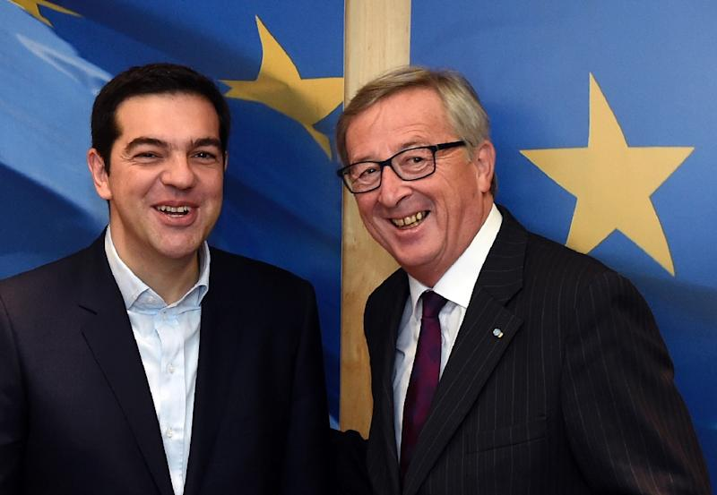 European Commission President Jean-Claude Juncker (R) greets Greek Prime Minister Alexis Tsipras in Brussels on February 4, 2015 (AFP Photo/John Thys)