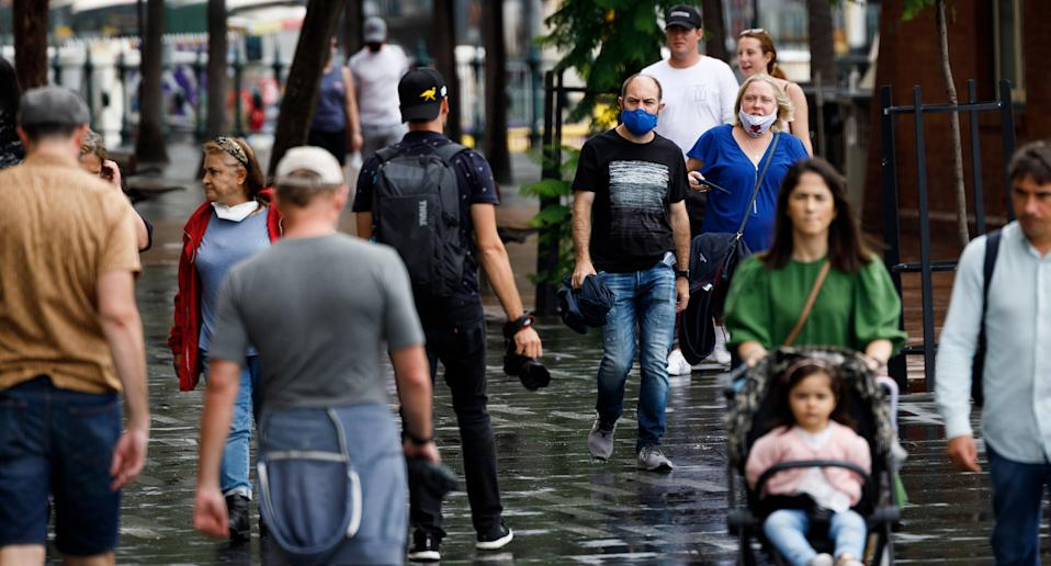 Shoppers in Sydney, some wearing face masks.