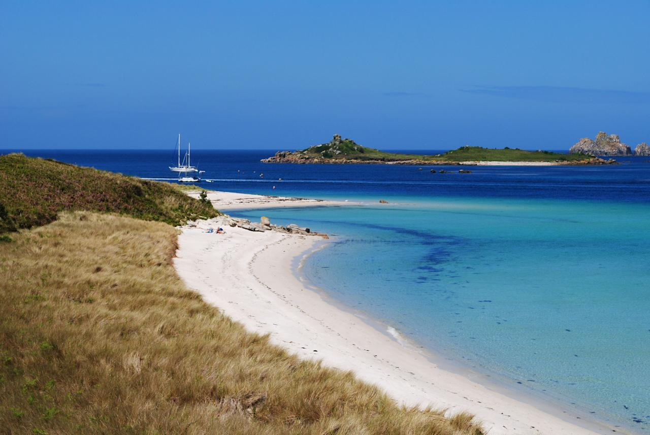 """<p>Home to more than 35 paradise beaches scattered across the archipelago, the <a href=""""https://www.countrylivingholidays.com/tours/isles-of-scilly-will-wagstaff"""" target=""""_blank"""">Isles of Scilly</a> is one of Britain's real treasures. </p><p>Proving that there's no need to catch a flight to experience turquoise waters, powder-soft sands and a milder climate, the Isles of Scilly are like nowhere else in England.</p><p>They're just a short ferry ride from the coast of Cornwall, with the likes of Tresco, Bryher and St Mary's attracting visitors to their sun-kissed beaches every summer.</p><p>Of course, there's more to the islands than their beaches (abundant wildlife, exotic gardens and plenty of scenic spots for walking) but they're not a bad place to start. </p><p>While we don't know when it will be safe to travel again (<a href=""""https://www.gov.uk/foreign-travel-advice"""" target=""""_blank"""">here's the government's latest advice</a>), we're happy to dream about the places we'd rather be and the Isles of Scilly are <a href=""""https://www.countryliving.com/uk/travel-ideas/abroad/g32666443/bucket-list-holidays/"""" target=""""_blank"""">high on our list</a>.</p><p>Here are some of the most stunning beaches in the Isles of Scilly...</p><p><strong><a href=""""https://www.countrylivingholidays.com/tours/isles-of-scilly-will-wagstaff"""" target=""""_blank"""">Country Living is visiting the Isles of Scilly on an exclusive tour with top guide Will Wagstaff, with boat trips to see Atlantic grey seals, seabird spotting, a visit to Tresco Abbey Garden and time to check out the beaches.</a></strong><strong></strong></p>"""