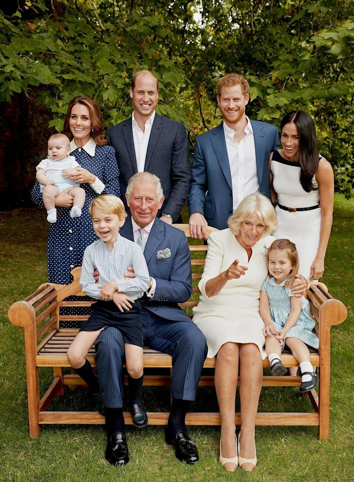 """<p>Look at that adorable laugh! In <a href=""""https://www.townandcountrymag.com/society/tradition/g25017880/prince-charles-70-birthday-portraits-royal-family/"""" rel=""""nofollow noopener"""" target=""""_blank"""" data-ylk=""""slk:the second portrait released"""" class=""""link rapid-noclick-resp"""">the second portrait released</a> for Prince Charles's birthday, a candid George is seen cracking up while sitting on Charles's lap.</p>"""