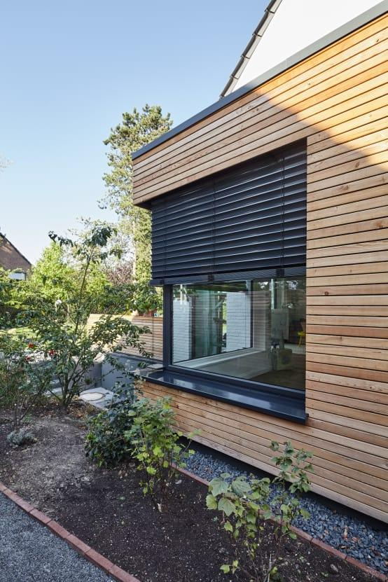 <p>The new extension is clad with timber panels, giving it a natural look that also stands out from the rest of the façade. And how fabulous is that corner window?</p>  Credits: homify / Schreinerei Fischbach GmbH & Co. KG