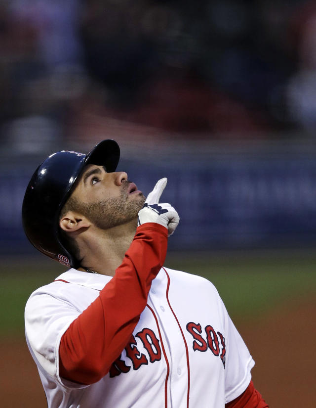Boston Red Sox's J.D. Martinez points upward as he crosses home plate on his three-run home run off Oakland Athletics starting pitcher Trevor Cahill during the first inning of a baseball game at Fenway Park in Boston, Wednesday, May 16, 2018. (AP Photo/Charles Krupa)