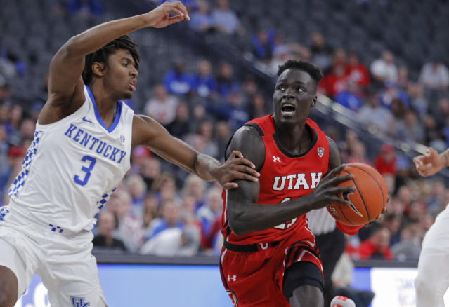 FILE - In this Wednesday, Dec. 18, 2019 file photo, Utah's Both Gach (11) drives around Kentucky's Tyrese Maxey (3) during the first half of an NCAA college basketball game in Las Vegas. Utah guard Both Gach has decided to transfer to Minnesota to play his last two seasons of college in his home state. Gach announced his move on Twitter on Monday, June 15, 2020. (AP Photo/John Locher, File)