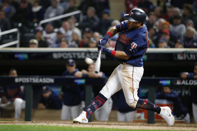Minnesota Twins' Eddie Rosario hits a solo home run during the eighth inning in Game 3 of a baseball American League Division Series against the New York Yankees, Monday, Oct. 7, 2019, in Minneapolis. (AP Photo/Bruce Kluckhohn)