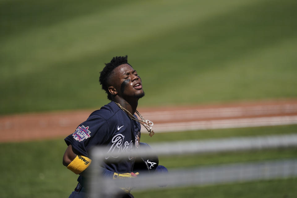 Atlanta Braves' Ronald Acuna Jr., (13) walks off the field after scoring in the first inning during a spring training baseball game against the Boston Red Sox on Monday, March 1, 2021, in Fort Myers, Fla. (AP Photo/Brynn Anderson)