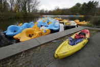 A kayak sits beside pedal boats for rent at Prospect Lake in Prospect Park, Sunday, Nov. 15, 2020, in the Brooklyn borough of New York, (AP Photo/Kathy Willens)