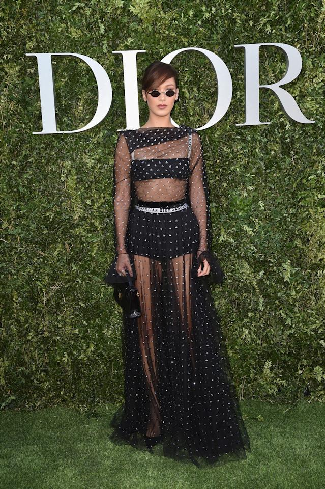 <p>This was one of Bella's more covered-up Dior looks and the semi-sheer gown definitely worked.<br /><i>[Photo: Dior]</i> </p>