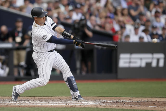 New York Yankees' Gary Sanchez hits a two-RBI single against the Boston Red Sox during the seventh inning of a baseball game in London, Sunday, June 30, 2019. (AP Photo/Tim Ireland)
