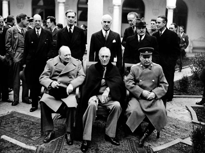 """British Prime Minister Winston Churchill, US President Franklin Roosevelt and USSR Secretary general of the Soviet Communist Party Joseph Stalin pose at the start of the Conference of the Allied powers in Yalta, Crimea, on February 4, 1945 at the end of World War II. During the Yalta Conference, which took place from February 4 to 11, 1945, """"The Big Three"""" (Stalin, Roosevelt, Churchill) decided the demilitarization and denazification of Germany and carved out their own post-war zones of influence across the globe.   / AFP PHOTO / TASS / -        (Photo credit should read -/AFP via Getty Images)"""