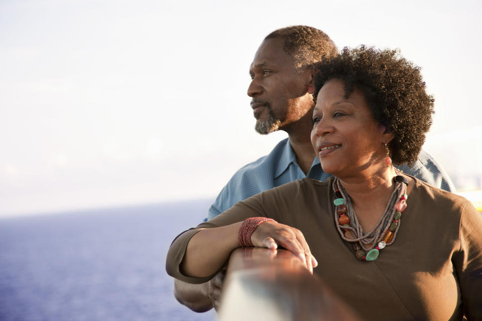 Mature African American couple on deck of a cruise ship, looking out into the ocean