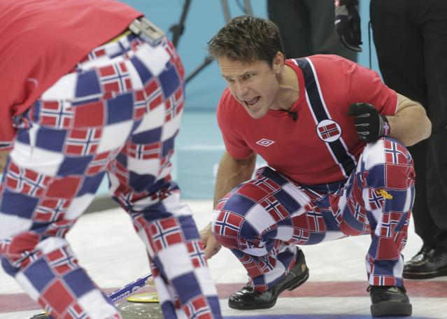 Norway's skip Thomas Ulsrud shouts to teammates during their men's curling round robin game against Switzerland in the Ice Cube Curling Centre at the Sochi 2014 Winter Olympic Games