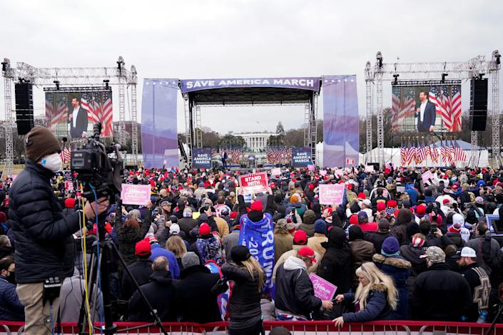 "People listen as Donald Trump Jr. speaks, Jan. 6, 2021, in Washington, at a rally in support of President Donald Trump called the ""Save America Rally."""