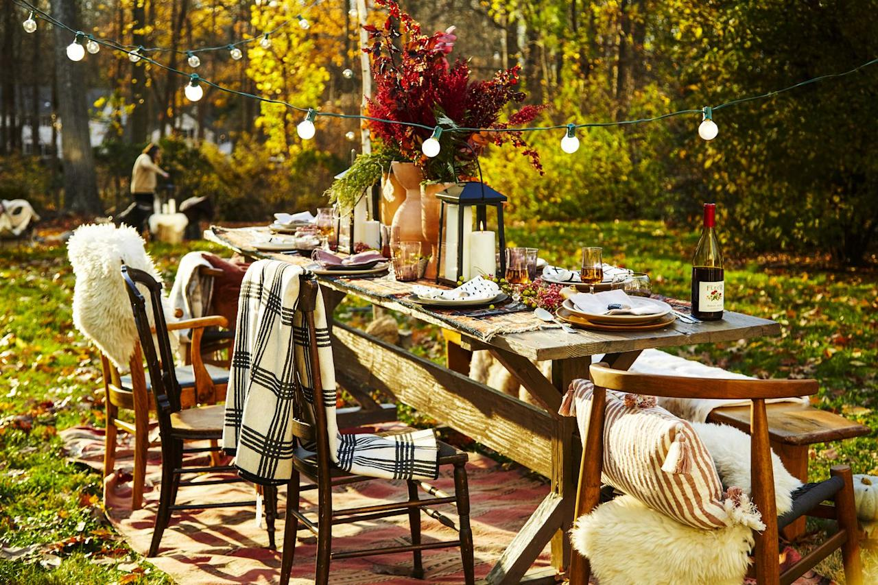 """<p>Soft, frosted bulbs help set the mood outdoors. Pro tip: Plant posts in the ground on either end of the table, then use 'em to attach string lights. </p><p><a rel=""""nofollow"""" href=""""https://www.amazon.com/Patio-String-Lights-Frosted-Globe/dp/B00L1E95W8"""">SHOP LIGHTS</a><br></p>"""
