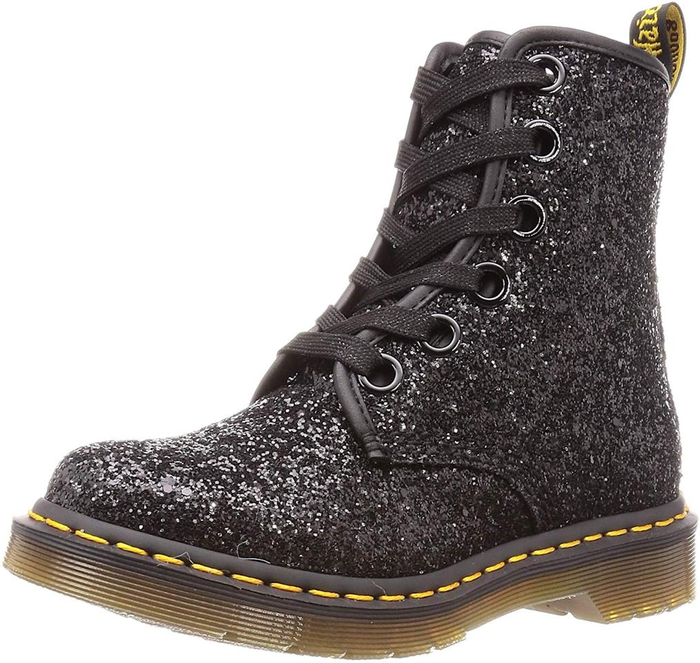 "<p>If gold isn't your thing, these fun black <a href=""https://www.popsugar.com/buy/Dr-Martens-Women-1460-Farrah-6-Eye-Boots-523971?p_name=Dr.%20Martens%20Women%27s%201460%20Farrah%206%20Eye%20Boots&retailer=amazon.com&pid=523971&price=126&evar1=fab%3Aus&evar9=45389435&evar98=https%3A%2F%2Fwww.popsugar.com%2Fphoto-gallery%2F45389435%2Fimage%2F45389439%2FDr-Martens-Women-1460-Farrah-6-Eye-Boots&list1=shopping%2Cshoes%2Cboots%2Choliday%2Cglitter%2Cdr.%20martens&prop13=api&pdata=1"" rel=""nofollow"" data-shoppable-link=""1"" target=""_blank"" class=""ga-track"" data-ga-category=""Related"" data-ga-label=""https://www.amazon.com/Dr-Martens-Womens-Farrah-Glitter/dp/B07M6R18GF/ref=sr_1_2?crid=1576NXJN0QPKW&amp;dchild=1&amp;keywords=glitter%2Bdr%2Bmartens&amp;qid=1574793322&amp;sprefix=glitter%2Bdr%2B%2Caps%2C354&amp;sr=8-2&amp;th=1"" data-ga-action=""In-Line Links"">Dr. Martens Women's 1460 Farrah 6 Eye Boots</a> ($126) are available on Amazon too. So pretty!</p>"