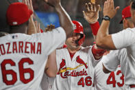 St. Louis Cardinals' Paul Goldschmidt (46) is congratulated by teammates in the dugout after hitting a grand slam during the third inning of a baseball game against the Milwaukee Brewers, Friday, Sept. 13, 2019, in St. Louis. (AP Photo/Jeff Roberson)