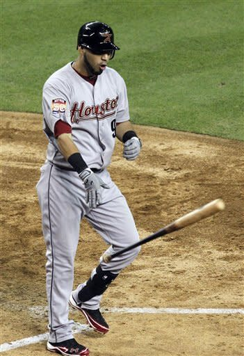 Houston Astros' Marwin Gonzalez yells as he throws his bat down after striking out against the Arizona Diamondbacks during the sixth inning in a baseball game Friday, July 20, 2012, in Phoenix. (AP Photo/Ross D. Franklin)