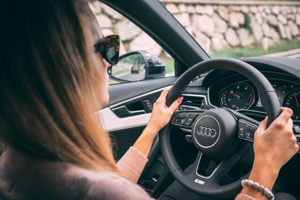 Gender discrimination is illegal, but women still pay more for car insurance premiums based on their jobs. (Andraz Lazic/Unsplash)