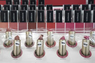 Lipstick samples covered in plastic to prevent use at an Ulta beauty store sit on display Thursday, Nov. 19, 2020, in a store on Chicago's Magnificent Mile. (AP Photo/Charles Rex Arbogast)