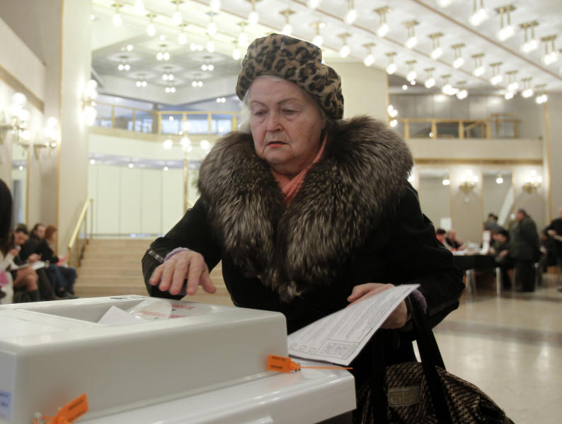 A Russian woman casts her ballot at a polling station in Moscow on Sunday, March 4, 2012. Polling stations have opened across Russia's vast expanse for the presidential election widely expected to return Vladimir Putin to the Kremlin. (AP Photo/Misha Japaridze)