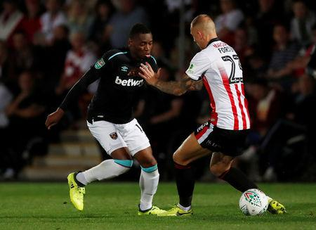 West Ham United's Diafra Sakho in action with Cheltenham Town's Jordon Forster.    Action Images via Reuters/Matthew Childs