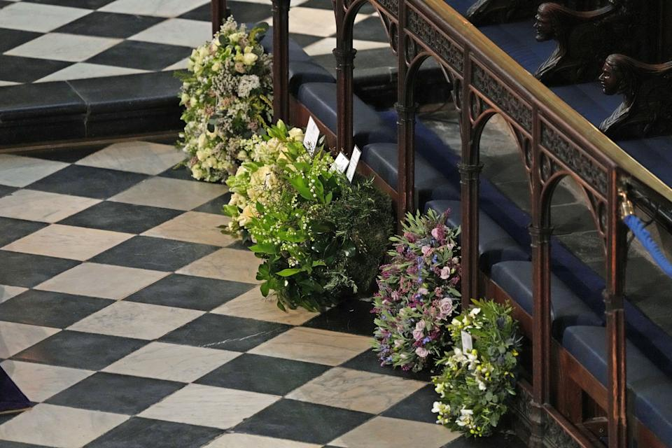 Wreaths from members of the royal family lie against the pews during the funeral. (Photo: WPA Pool via Getty Images)