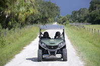 """Florida Fish and Wildlife Commission officers ride up a private road near the entrance of the Carlton Reserve during a search for Brian Laundrie, Tuesday, Sept. 21, 2021, in Venice, Fla. Laundrie is a person of interest in the disappearance of his girlfriend, Gabrielle """"Gabby"""" Petito. (AP Photo/Phelan M. Ebenhack)"""