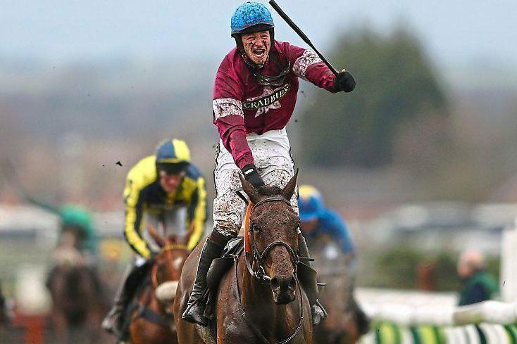 Home safe: David Mullins winning last year's Grand National on Rule the World