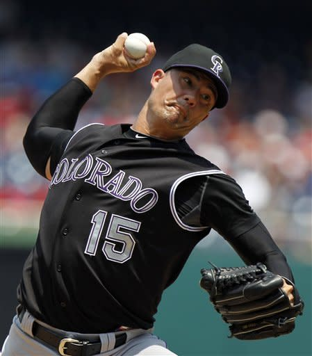 Colorado Rockies starting pitcher Jeremy Guthrie (15) throws during the first inning of a baseball game agains the Washington Nationals, Sunday, July 8, 2012, in Washington. (AP Photo/Alex Brandon)