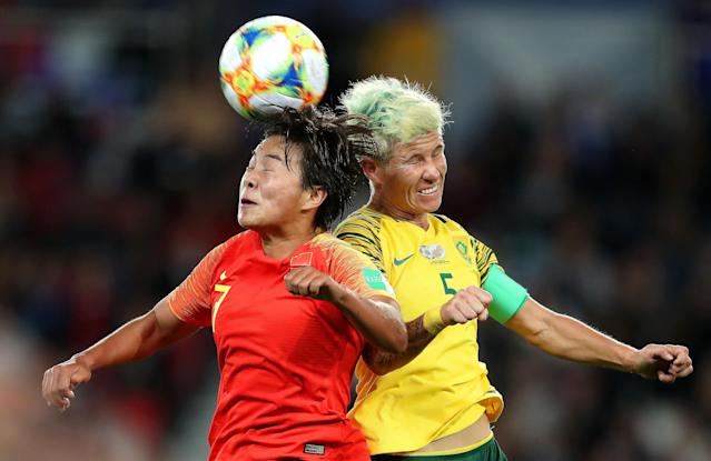 PARIS, FRANCE - JUNE 13: Shuang Wang of China competes for a header with Janine Van Wyk of South Africa during the 2019 FIFA Women's World Cup France group B match between South Africa and China PR at Parc des Princes on June 13, 2019 in Paris, France. (Photo by Catherine Ivill - FIFA/FIFA via Getty Images)