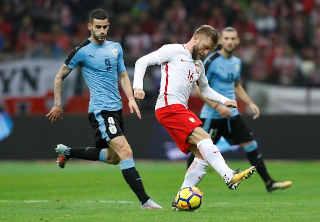 Soccer Football - International Friendly - Poland v Uruguay - National Stadium Warsaw, Warsaw, Poland - November 10, 2017 Poland's Jakub Blaszczykowski in action with Uruguay's Gaston Pereiro REUTERS/Kacper Pempel