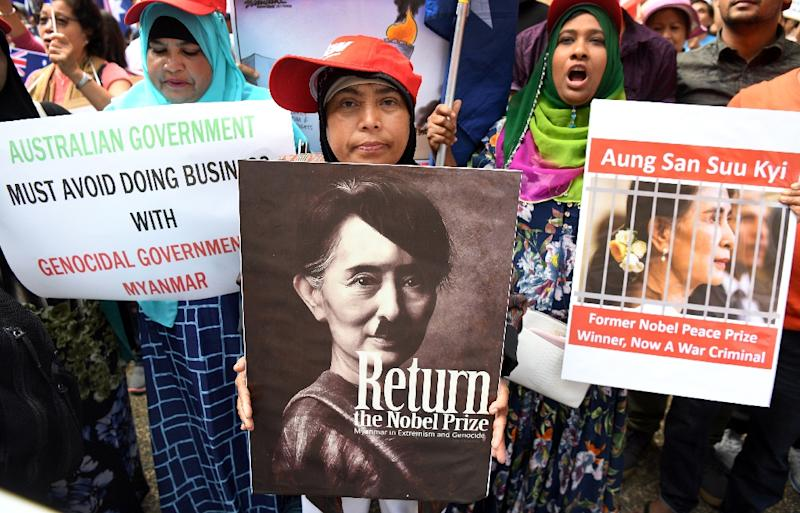 Protesters demonstrate against Myanmar's Aung San Suu Kyi during the ASEAN-Australia Special Summit in Sydney