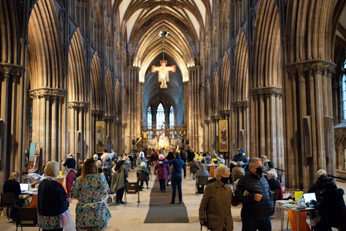 Members of the public at Lichfield Cathedral, Staffordshire, to receive the Oxford/AstraZeneca coronavirus vaccine.PA